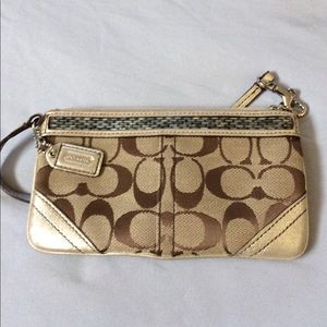 Gold metallic trim Signature coach wristlet